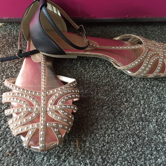 6549697e8 Restricted Shoes | Tan And Black Flat Sandals With Decorative Studs ...